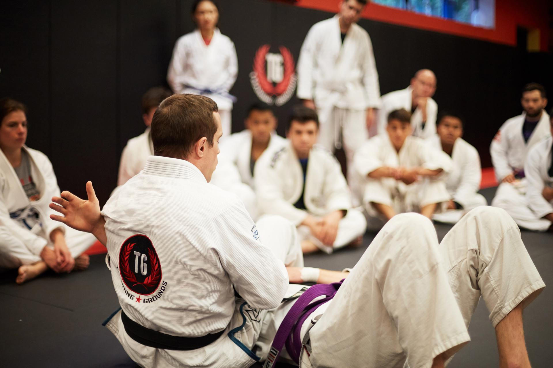 A view inside a martial arts school in bergen county where an instructor is teaching his student how to perform an armbar