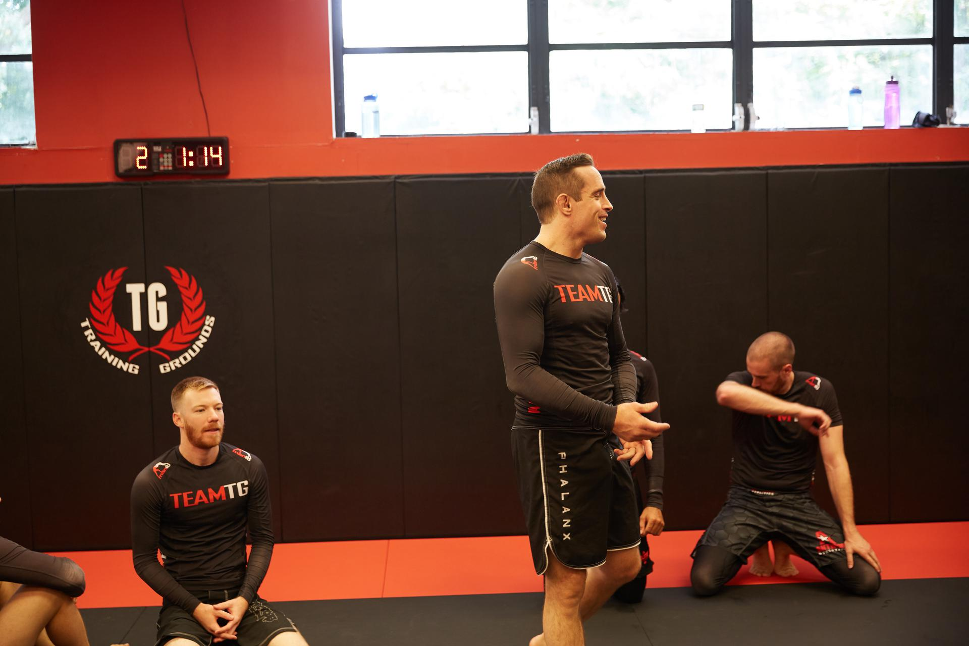 a strong guy laughing during his bjj class
