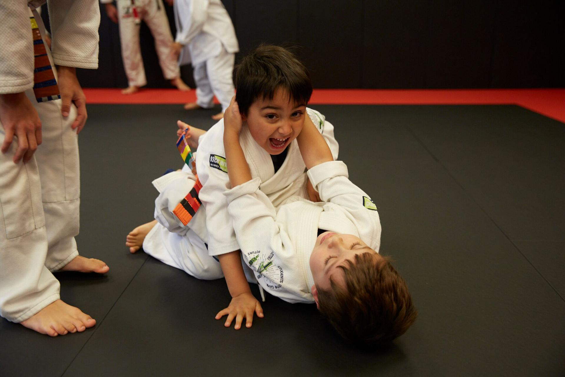 two 5 year old kids working on their bulletproofing and martial arts