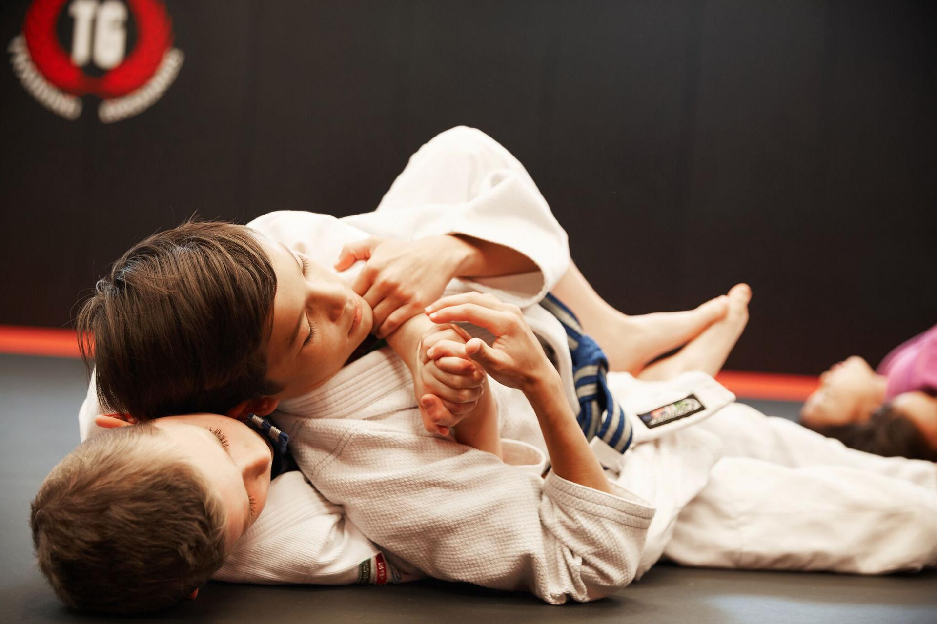 two children getting fit by practicing BJJ near westwood nj